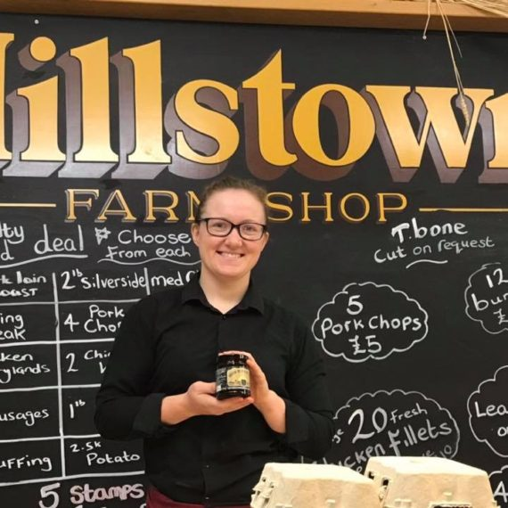 Rebecca at Hillstown Farmshop with jars of Irish Black Butter